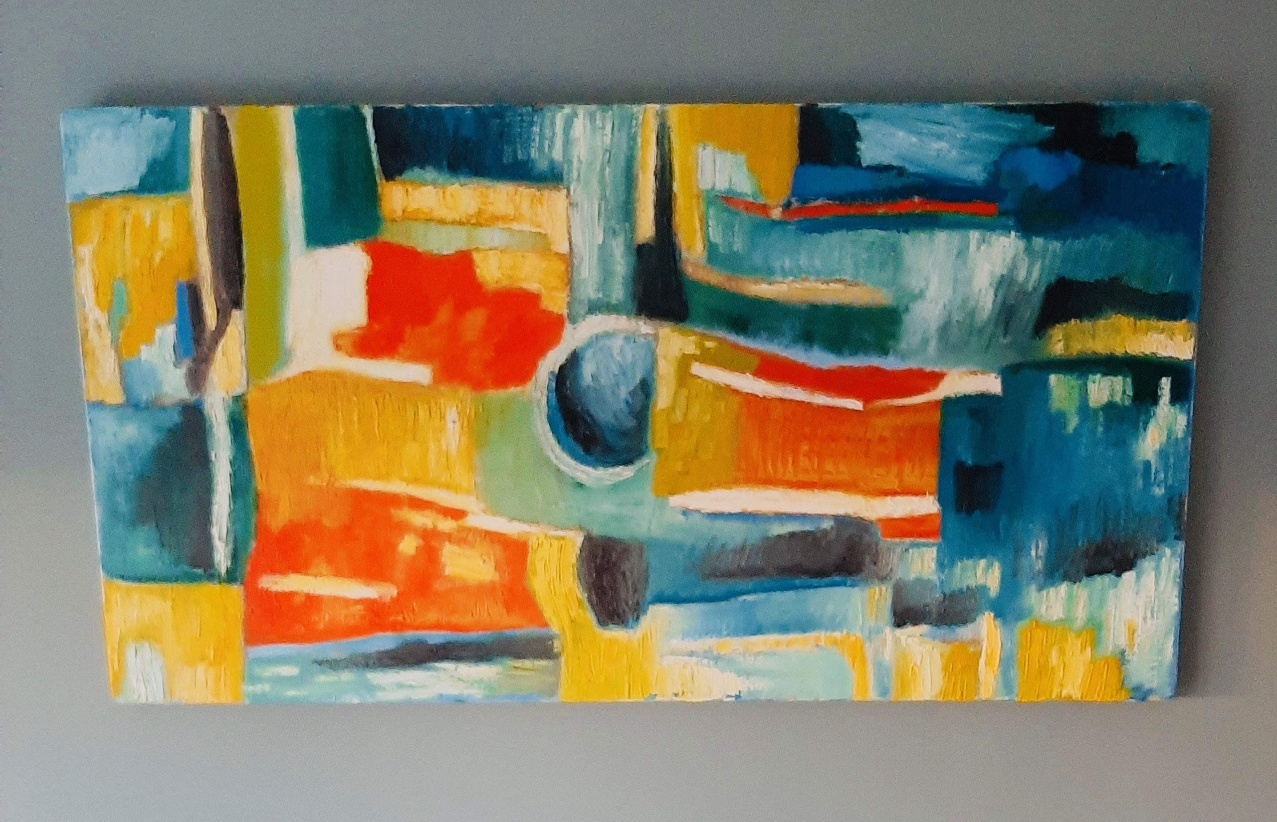 An abstract painting with cuboid-ish blocks of orange, yellow, and blue.